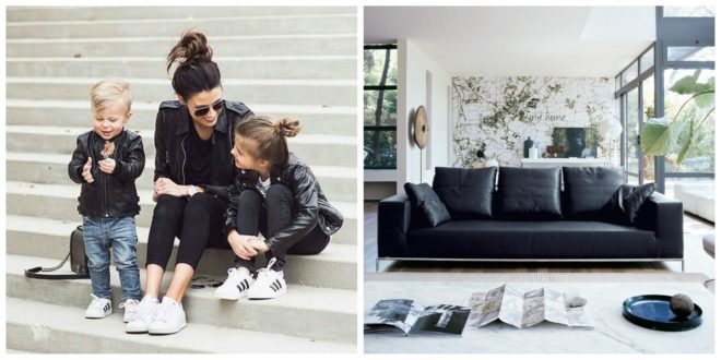 Mom and 2 small children on steps next to a living room with a leather couch in similar style