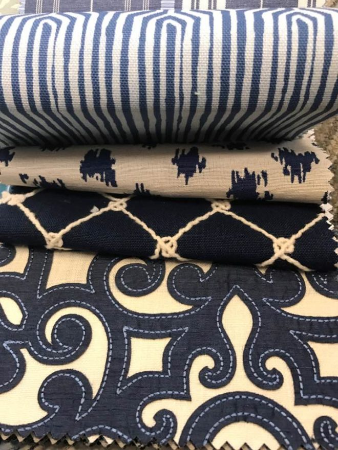 4 different fabrics with royal and navy blue patterns