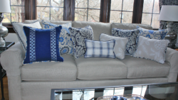 Custom made pillows using mix and match patterns in blue and white that add impact to a room