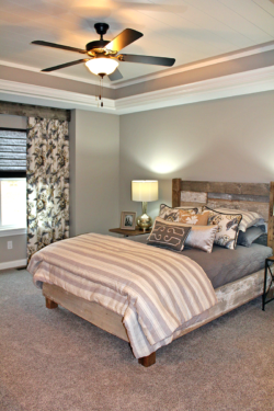 Bedroom window treatment ideas for this room are coordinating custom drapery panels, Hunter Douglas soft fold Vignette shade