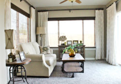 Custom window treatments are floor length drapes that add flare to the room