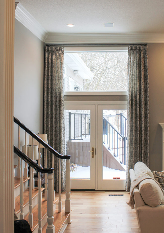 Goblet pleated custom drapes that frame the doorway in an elegant and formal manner.